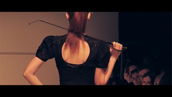 Manufaktur Herzblut @ Vienna Fashion Week 2011: Model with riding crop.
