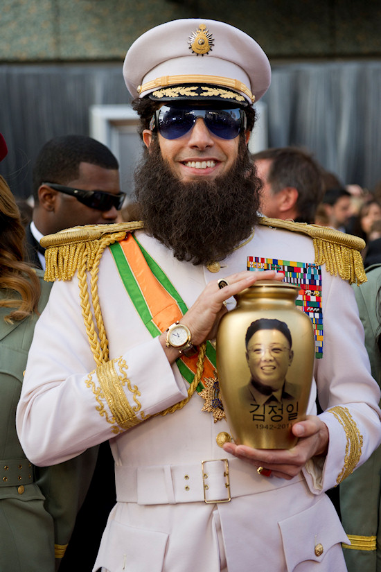 Oscars 2012: Sacha Baron Cohen as The Dictator with fake urn of Kim Jong-il