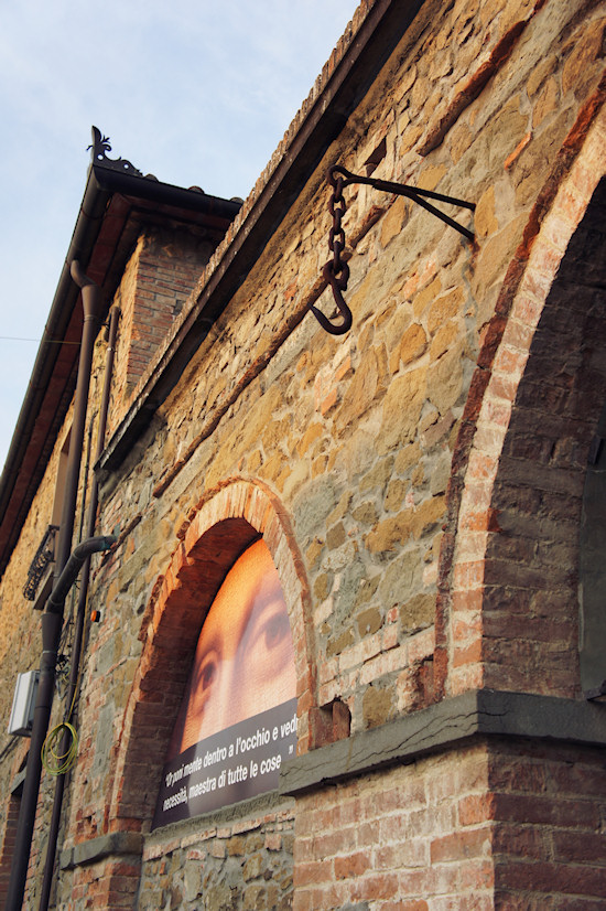 Vinci, Italy: Chain and hook in the stone wall.