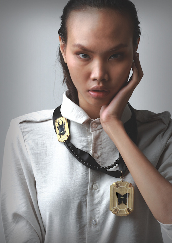 Thai model with deux charms necklace by Wonder Anatomie