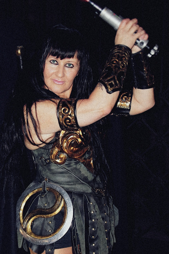 Xena Zellich as Xena with a light saber