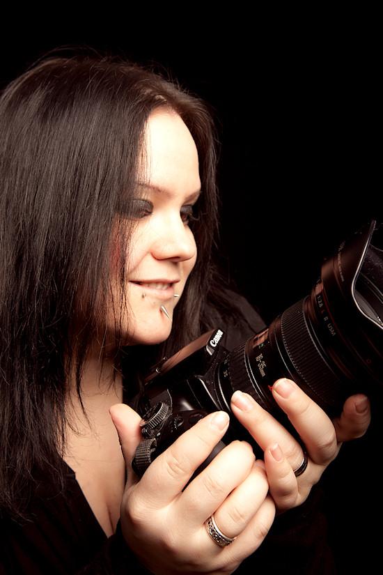 Ancalime: Self-Portrait holding Canon DSLR Camera