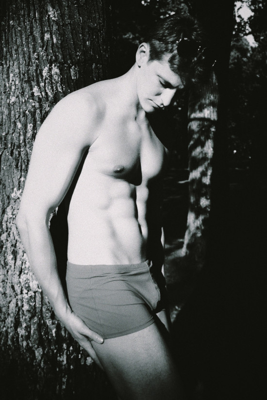 Bodybuilder Male Fitness Model In The Woods