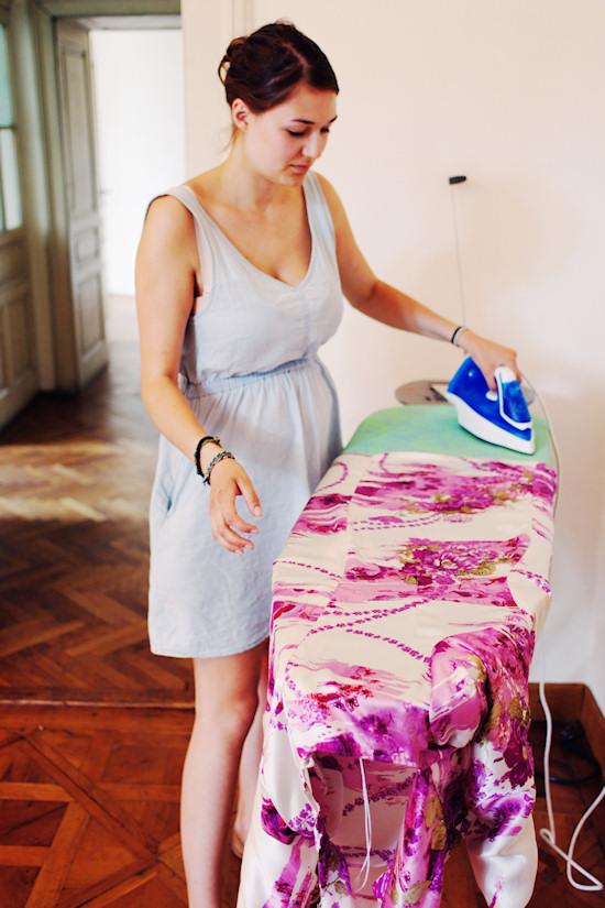 Ironing a dress.