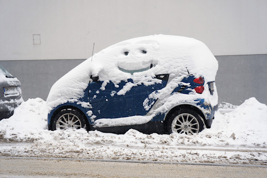 Smart Car covered with snow and with a smiley :)