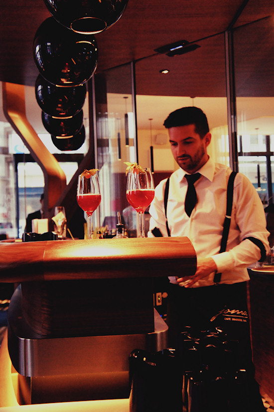Waiter serving New Kir Cocktail @ Joma Bar Wien