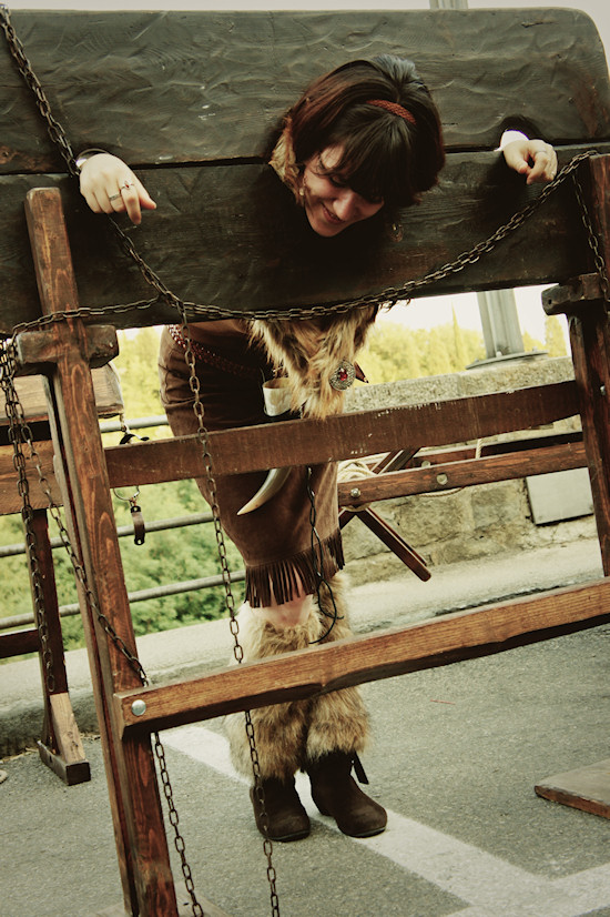 Girl locked in medieval pillory