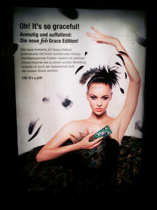 Feh Billboard: Peacocking Model with Photoshop warning. Model Anna Kuen.