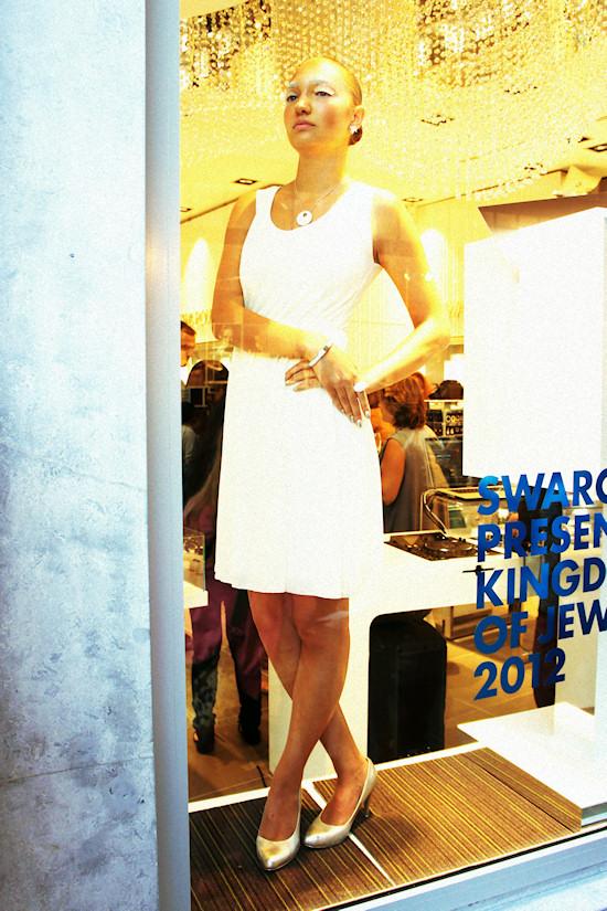 Model posing behind the window @ Swarovski Shop in Amsterdam. Dam Square 6.