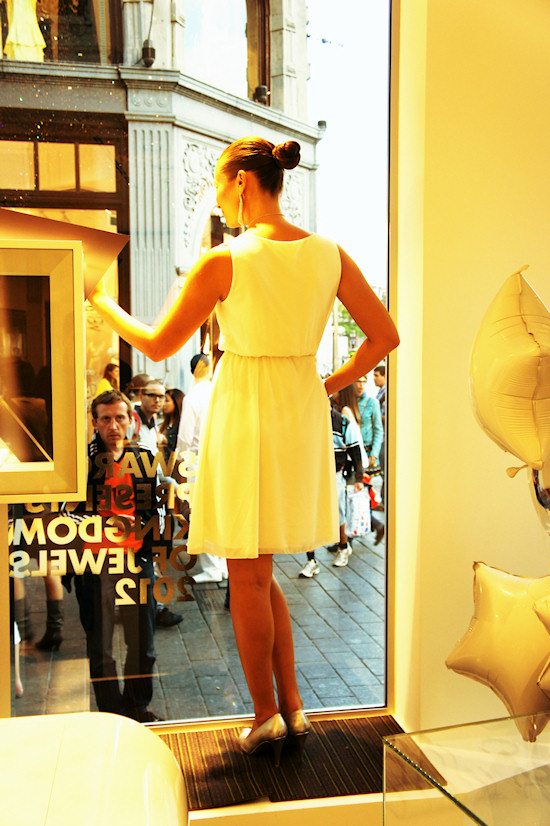 Model posing behind the window @ Swarovski Shop in Amsterdam. Dam Square 6.