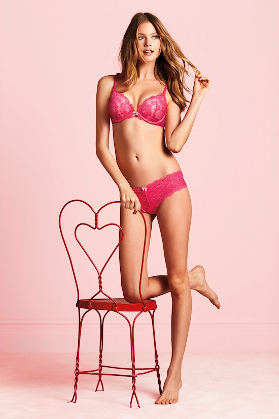 Victoria's Secret Angel: Behati Prinsloo in bombshell lingerie in front of v-day chair with a heart