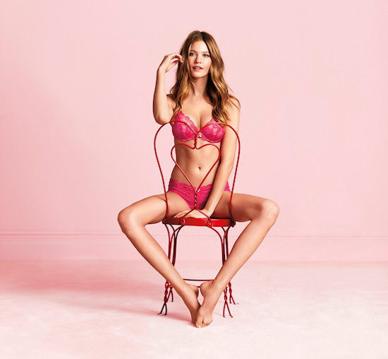 Victoria's Secret Angel: Behati Prinsloo in bombshell lingerie sitting on v-day chair