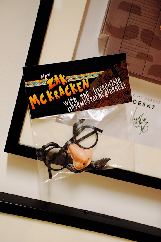"""Play Zack McKracken with the incredible nose mustache glasses!"" by Desk7 @ We Love 8-Bit exhibition Vienna"