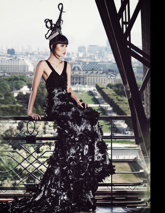 Jessica Minh Anh ascending the Eiffel Tower in a couture dress by Dar Naseem AlAndalos.