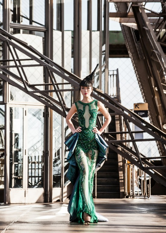 Jessica Minh Anh in a couture dress by Hoang Hai on the Eiffel Tower.