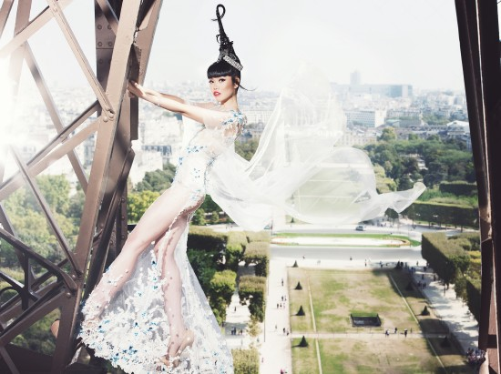 Jessica Minh Anh in a dream-like white dress by Hoang Hai at the Eiffel Tower.