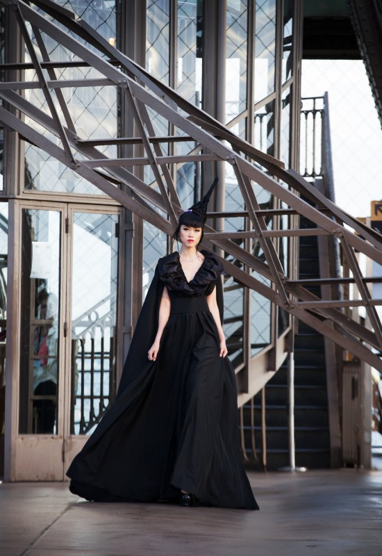 Jessica Minh Anh in a couture dress by Debaj on the Eiffel Tower.