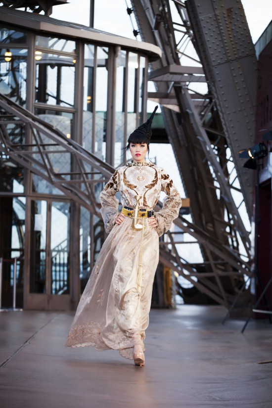 Jessica Minh Anh in a couture dress by OM Fiore on the Eiffel Tower.