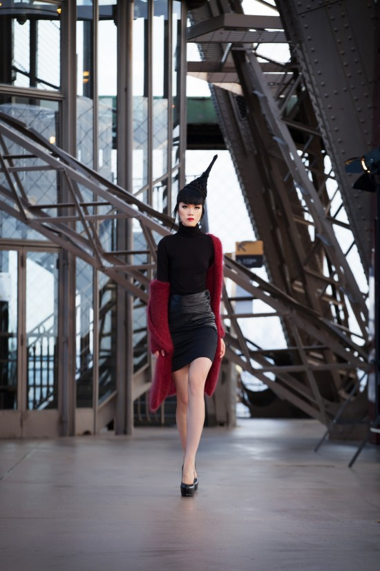 Jessica Minh Anh in a couture dress by Soul Made Faroe Islands on the Eiffel Tower.