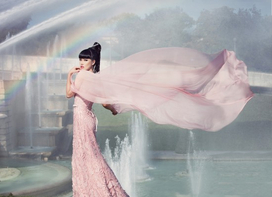 Jessica Minh Anh in a couture dress by Dar Naseem AlAndalos at the Eiffel Tower.