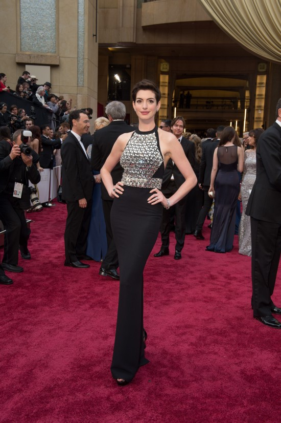 Anne Hathaway in a black studded halter dress by Gucci @ Oscars 2014
