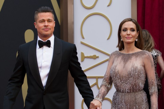 Brad Pitt and Angelina Jolie in a sparkling long-sleeved dress by Elie Saab @ Oscars 2014