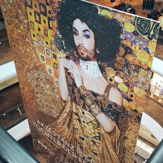 Life Ball 2015 poster with Conchita Wurst as Gustav Klimt's Adele @ Gerngross shopping center. Conchita Wurst photographed by Ellen von Unwerth.