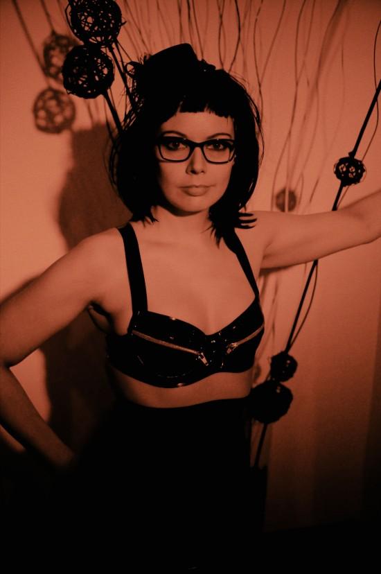 Latex model Michaela in a black latex bra @ Rubberik Latex Fashion Show at Club Mysticum